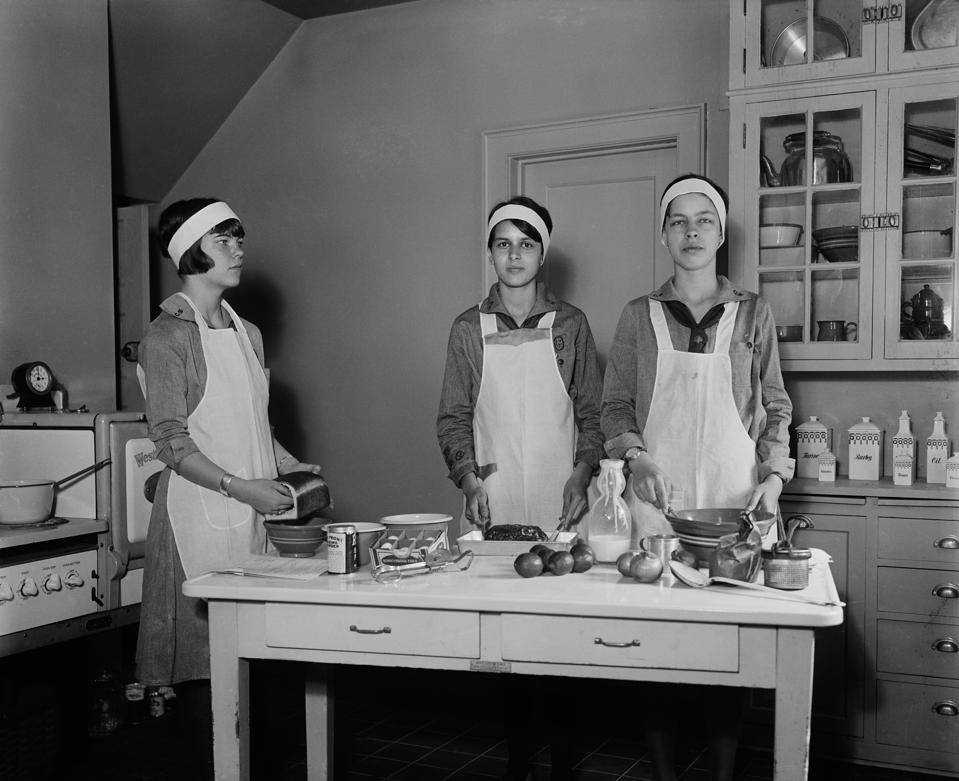 Girl Scouts preparing food in the kitchen, Harris and Ewing, 1931